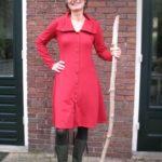 Hoe een rode jurk de grauwsluier opheft